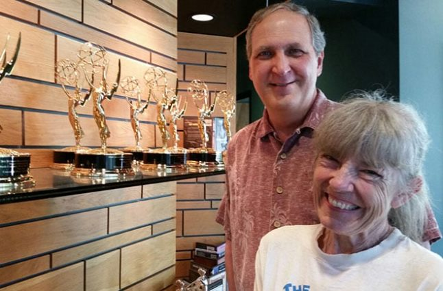 Fred and wife Becky with their awards display.