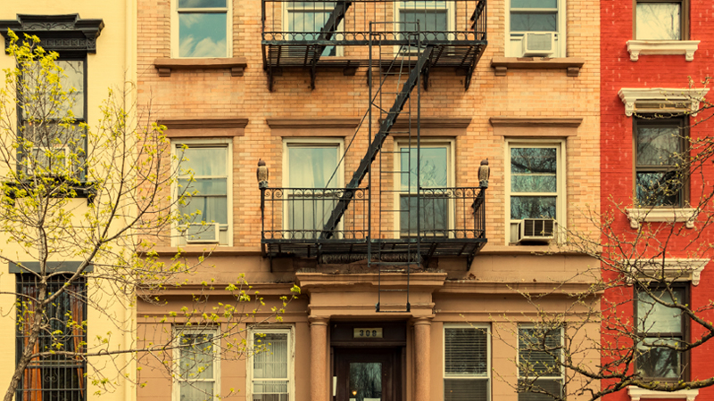 Brick rowhouses with a black fire escape.