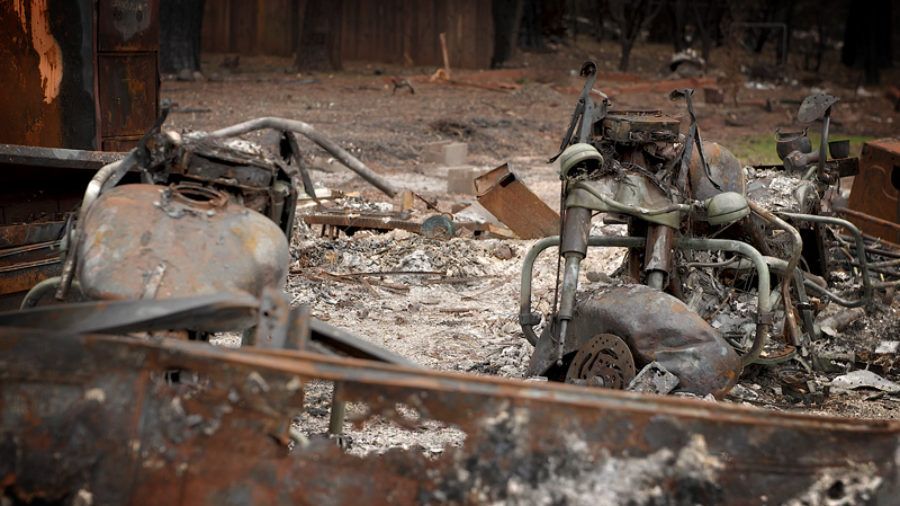Photo of burned-out motorcycles at a home destroyed by the Camp Fire in Paradise, California.