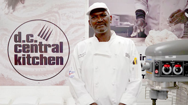 Story Type Indicator - video. William Ferrell stands in a kitchen in front of a sign that reads D.C. Central Kitchen. He is wearing a white chef coat and a white hat.
