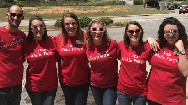 The Anderson, S.C., Wells Fargo branch team sporting their eclipse glasses and Wells Fargo T-shirts.