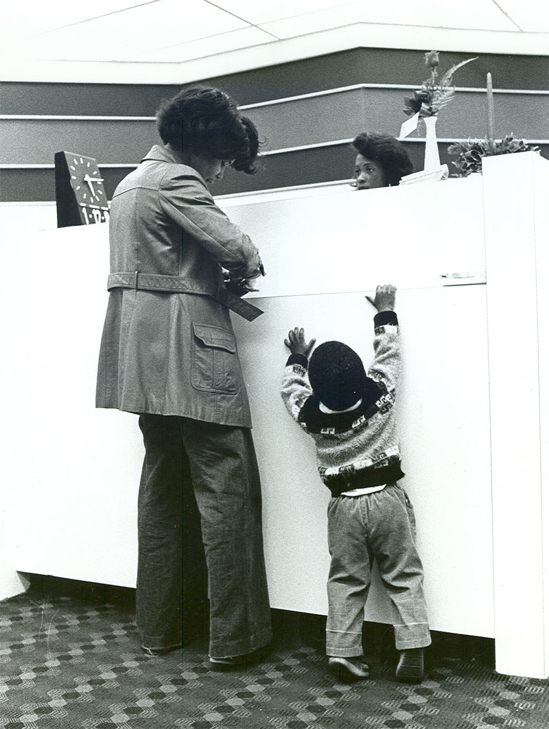 A mother and child banking at Wells Fargo in the 1970s.