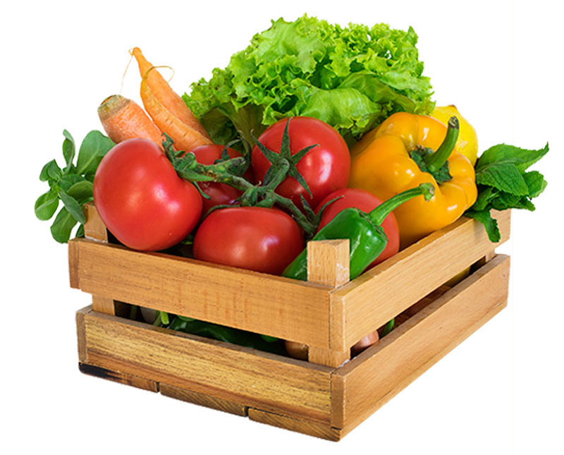 A wooden crate is shown with an overflowing amount of produce. There are a few red tomatoes, a green pepper, a yellow pepper, a few carrots, a lemon, some lettuce, and some herbs shown.