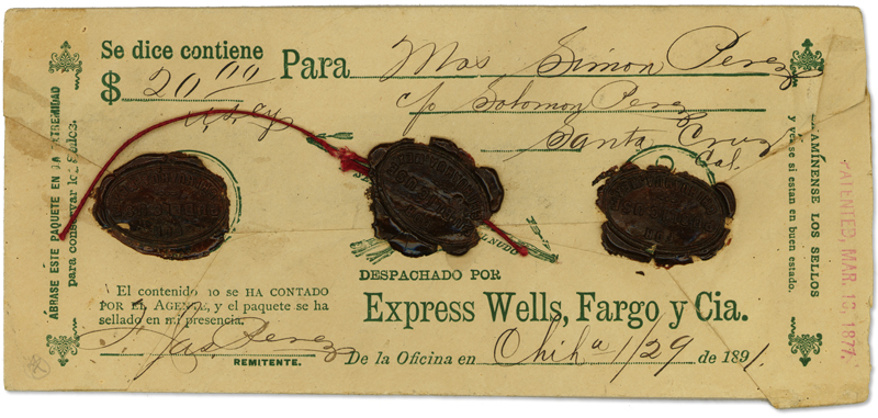 An aged envelope has worn writing with the amount of $20. It also shows Express Wells Fargo y Cia.