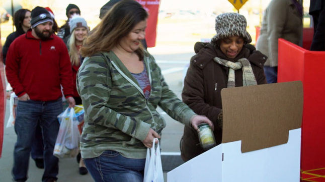 Wells Fargo team members donate food at a pop-up food bank in West Des Moines, Iowa