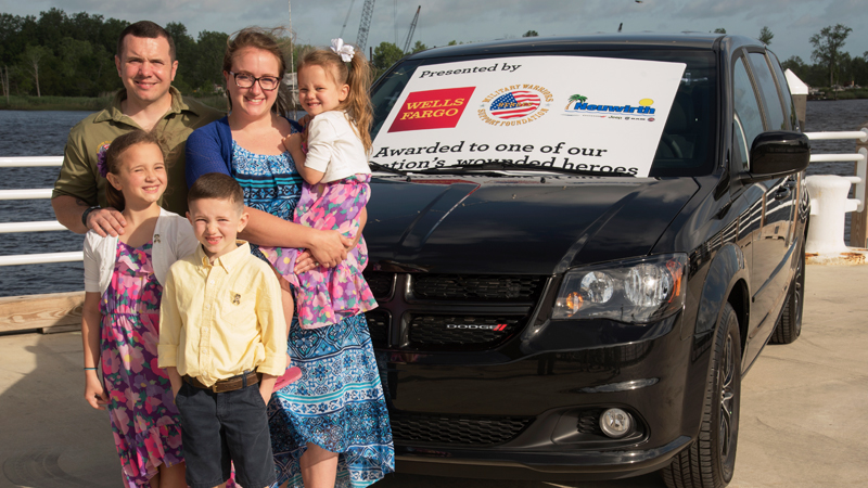 Clockwise: U.S. Army veteran and Purple Heart recipient Tristan Michael Brown, his wife Merrilynn, and children Avynnleigh, Mason, and Madilynn Brown with their new, payment-free minivan, donated by Wells Fargo.
