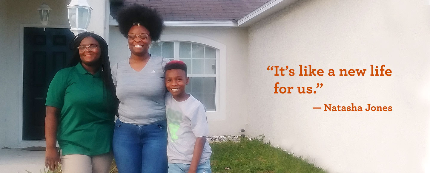 Natasha Jones, center, with her children, Markayla Williams and Damian Jones, in front of their home.