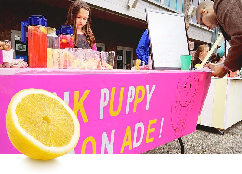 "Charlotte Bittner and her lemonade stand, ""Pink Puppy Lemonade."""