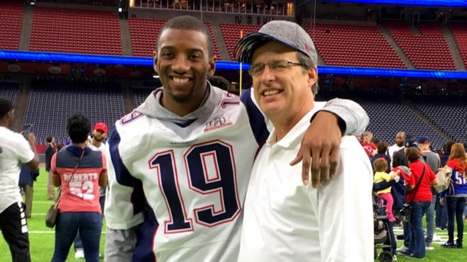 Malcolm Mitchell David Sapp in a football stadium