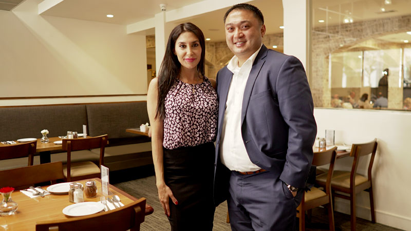 Sadaf Salout and Mike Bulda stand in Salout's Encino, CA, restaurant.