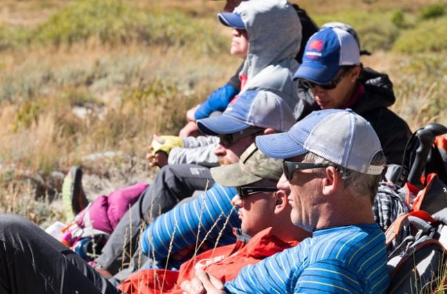 Team members sit in the late summer sunshine before resuming the trail.