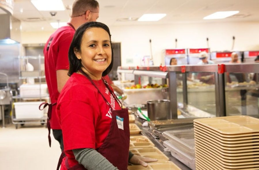 Mariana Phipps in a hairnet to serve food at St. Anthony's.