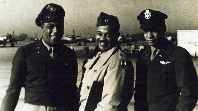 This undated photo shows James Walker (center), a member of the Tuskegee Airmen, during his military days in the Army Air Corps.