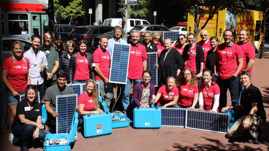 Participants in the San Francisco workshop show off their Solar Suitcases.