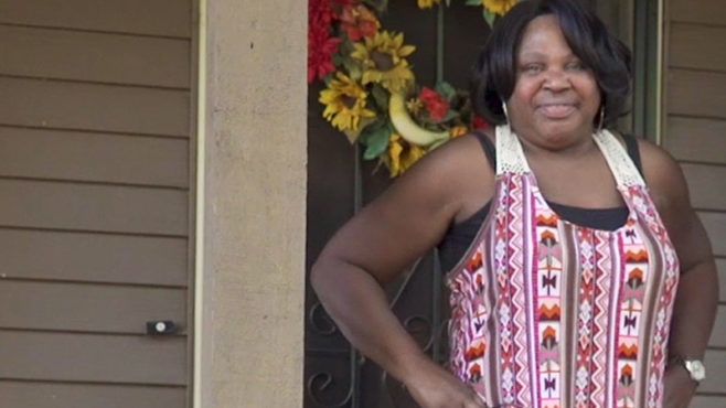 Story Type Indicator - video. image of homeowner Athena Emerson on her front porch