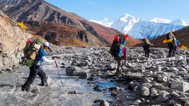 Story Type Indicator - video. Members of the 2017 Warriors to Summits team cross a glacial stream in the backcountry of Denali National Park & Preserve.